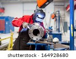 welder with protective mask... | Shutterstock . vector #164928680