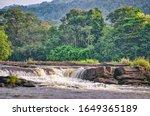 Waterfall Through Rocks In A...