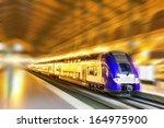 modern fast passenger train.... | Shutterstock . vector #164975900