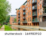 residential building on the... | Shutterstock . vector #164983910