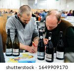 Small photo of Strasbourg, France - Feb 16, 2020: Contract signing for French wine delivery at the Vignerons independant English: Independent winemakers of France wine fair for private and horeca customers