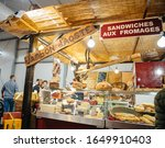 Small photo of Strasbourg, France - Feb 16, 2020: Booth stall selling traditional Jambon D'aoste sandwich with cheese at Vignerons independant English: Independent winemakers of France wine