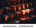 Two Burning Candles Among...