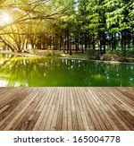 wooden platform and forest   Shutterstock . vector #165004778