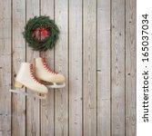 skates hanging on the wooden... | Shutterstock . vector #165037034
