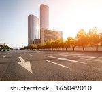 asphalt road and modern city   Shutterstock . vector #165049010
