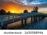 Village river bridge at sunset...