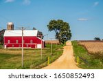 Red Barn With White Roof By...