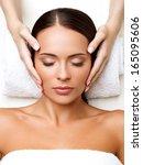 face massage. close up of a... | Shutterstock . vector #165095606