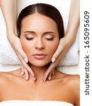 face massage. close up of a... | Shutterstock . vector #165095609