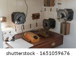 Small photo of Morse old vintage with morse key telegraph on old desk in HMS M33 Royal Navy warship in the First World War showing at Portsmouth Historic Dockyard Museum, UK.