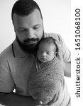 newborn baby boy  being held by ... | Shutterstock . vector #1651068100
