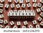 Small photo of Covenant word concept on cubes