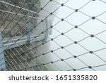 Blurred wire mesh shape with the foggy mountain thrill walk background in Switzerland (focused on the thrill walk)