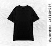 t shirt mock up mock up men... | Shutterstock . vector #1651684399