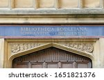translation is Bodleian Library School of Ancient Jurisprudence or Law on one of the doors to a building in the main library quad near the Radcliffe Camera and the Sheldonian Theatre