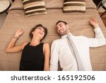 Stock photo happy young couple relaxing in hotel room 165192506