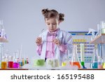 concentrated girl looks at... | Shutterstock . vector #165195488