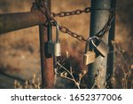 Three Rusty Padlocks With A...