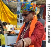 Small photo of Faridabad, Surajkund, India, February 2020 : Surajkund International Crafts Mela, bioscope wala