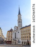 Small photo of Vienna, Austria - July 20, 2019: Michaelerplatz Square (St. Michael's Square). Church of St. Michael (Katholische Kirche St. Michael) Catholic Church