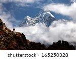 Small photo of Trekker below Ama Dablam in the Nepal Himalaya