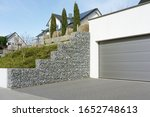 Garage Entrance And Gabion Wall