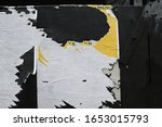 Small photo of Poster paper texture ripped off an exterior street wall