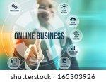 business man selecting online... | Shutterstock . vector #165303926