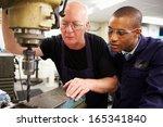 engineer teaching apprentice to ... | Shutterstock . vector #165341840