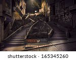 Staircase With Graffiti In...