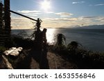 Person Sits Silhouetted At The...