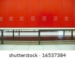 Red doors and bench in a locker room - stock photo