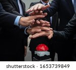 Hand From Businessmen Pushing...