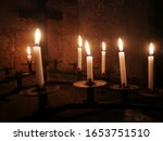 Lit Votive Candles In Front Of...