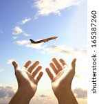 hands reach for airplane  close ... | Shutterstock . vector #165387260
