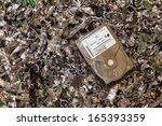 A Hard Drive Resting On A Pile...