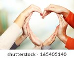 human hands in heart shape on...