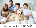 portrait of happy family with... | Shutterstock . vector #165426680