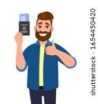 young man showing passport... | Shutterstock .eps vector #1654450420