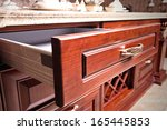 Stock photo wooden cupboard with opened empty drawer 165445853