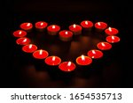 Red Burning Candles In The...