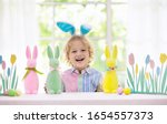 Kids Dyeing Easter Eggs....