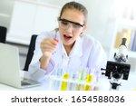 young female scientist run an... | Shutterstock . vector #1654588036