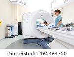 mid adult nurse preparing... | Shutterstock . vector #165464750