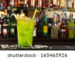 green apple cocktail on the bar ... | Shutterstock . vector #165465926