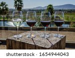 Glasses of wine at lake in Guadalupe valley