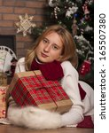 happy girl with presents near... | Shutterstock . vector #165507380