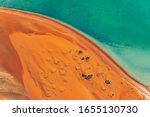 An Aerial View Of Sand Dunes...