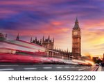Big Ben With Red Bus Against...